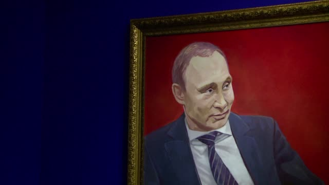 From a musclebound Superman to ice hockey player to jet pilot Vladimir Putin plays various heroic roles in paintings at a Moscow exhibition called...