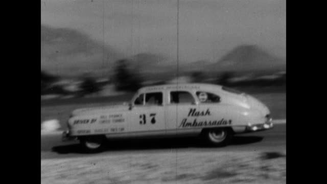 / From a Nash Motors promotional film this segment shows NASCAR founder Bill France Sr and race car driver Curtis Turner driving the NASCAR pace car...