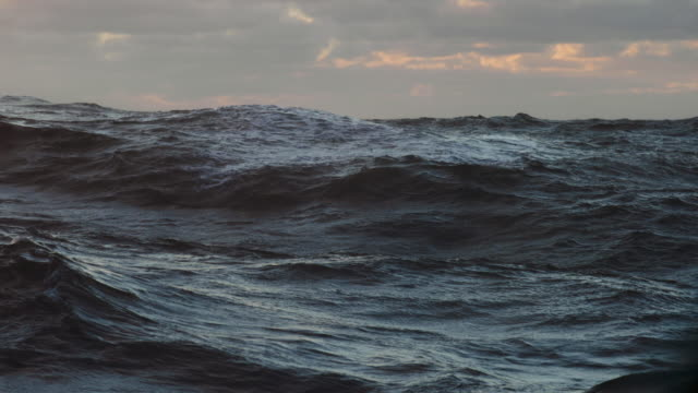 from a sailing a vessel: blue sea at sunset - wave pattern stock videos & royalty-free footage