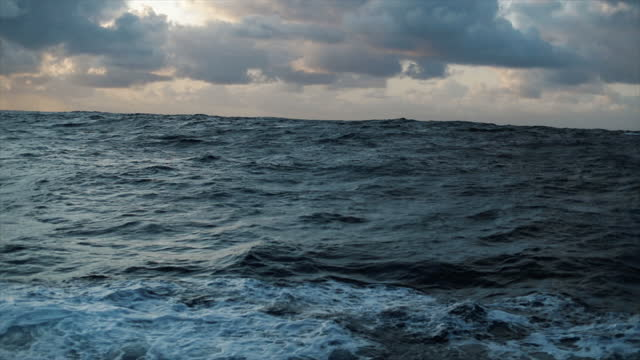 from a vessel in a blue rough sea at night: waves dark sea view - rough stock videos & royalty-free footage