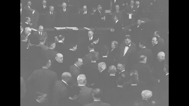 from above and behind congressional aides carry electoral ballot boxes past standing applauding members of congress / closer side shot of aides... - joint session of congress stock videos and b-roll footage