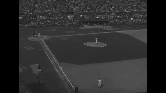 springfield cubs outfielder jack wallaesa get on first on error / group of boys lying on grass in front of stands watch game - jugendmannschaft stock-videos und b-roll-filmmaterial