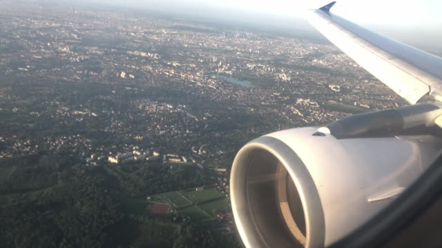 "pov from aeroplane window of plane landing on flight from berlin to paris - ""bbc news"" stock-videos und b-roll-filmmaterial"