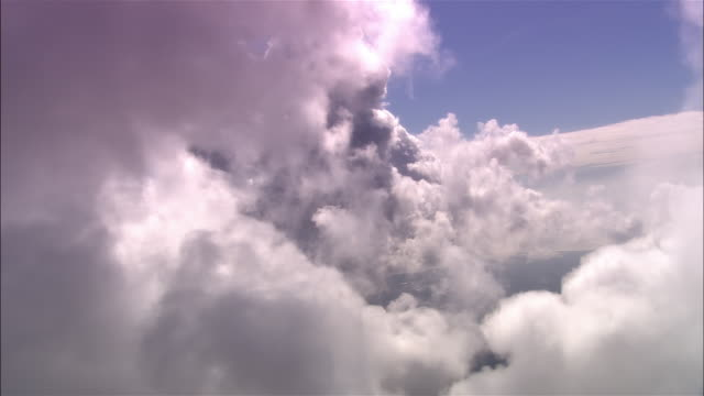 POV, from airplane clouds, Dorset, England