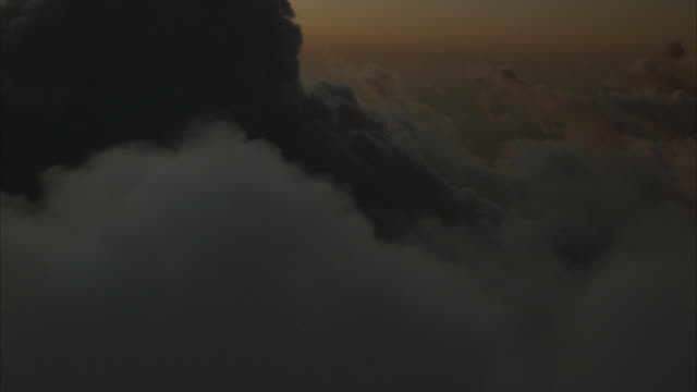 POV from airplane flying through heavy clouds