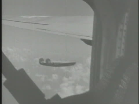 north american b25 mitchell medium bomber aircraft flying over clouds aerial ws flying pass island of iwo jima japan w/ smoke in distance wwii air... - schlacht um iwojima stock-videos und b-roll-filmmaterial