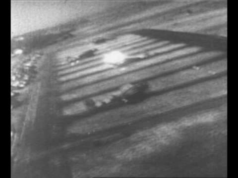 pov from allied plane as it fires at german planes parked on airfield huge explosions ensue as luftwaffe craft are destroyed / from greatest... - luftwaffe stock videos and b-roll footage