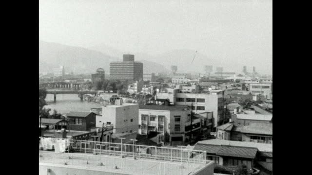 zo from atomic bomb dome over hiroshima city; 1966 - symbols of peace stock videos & royalty-free footage