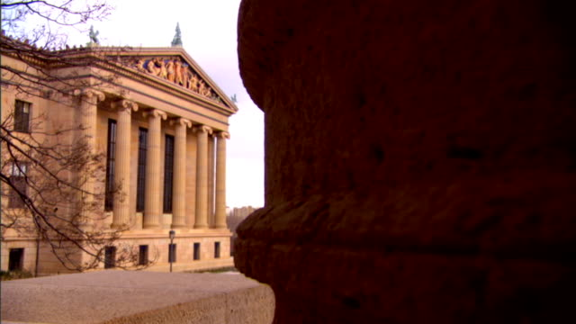 racking focus from base of pillar fg to side facade of philadelphia museum of art w/ 'western civilization' decorative pediment bg greek revival... - decorative art stock videos and b-roll footage