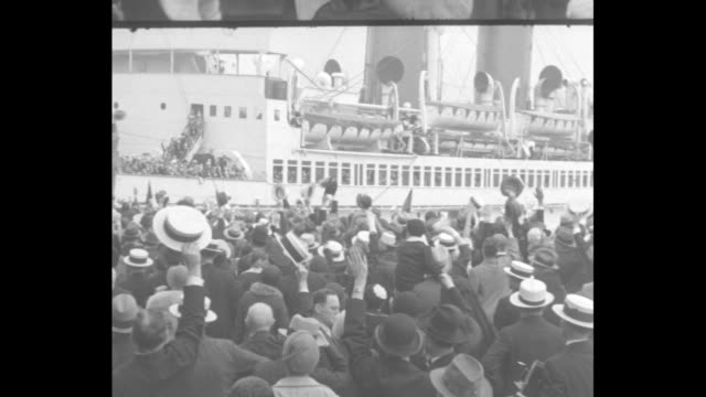 ms from behind crowd on docks as it waves the ss de grasse off as it departs with cardinal patrick hayes on board hayes the archbishop of new york is... - waving stock videos & royalty-free footage
