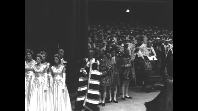 pov from behind king edward's chair pan across queen elizabeth ii's ladiesinwaiting to ws peers and peeresses wearing coronets as they sit in the... - coronation of queen elizabeth ii stock videos and b-roll footage