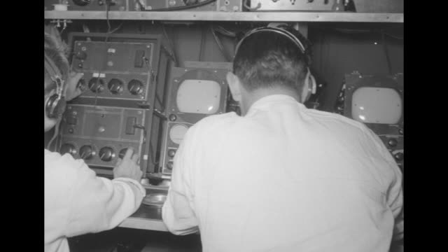men work at broadcasting control panel / pan hands adjusting dials and buttons monitor / cu kgotv television american broadcasting company on side of... - audio equipment stock videos & royalty-free footage