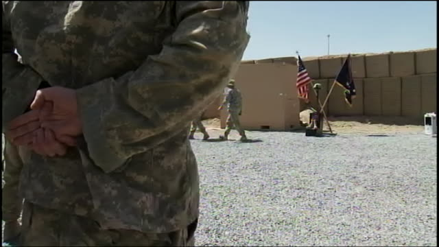 from behind the back of a standing officer, armed and uniformed us soldiers train at army base in kabul during war in afghanistan - afghan national army stock videos & royalty-free footage