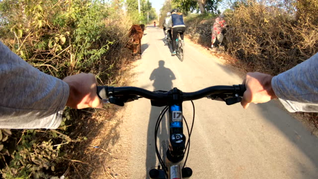 pov from bicyclist handlebars looking towards fellow bicyclists - viewpoint stock videos & royalty-free footage