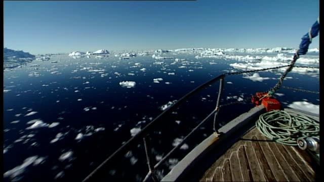 from boughs of ship past small icebergs and floating ice at sea - sea passage stock videos and b-roll footage