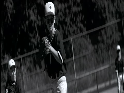 b/w canted swish pan from boy pitching to catcher at home plate / little league baseball - youth baseball and softball league stock videos and b-roll footage