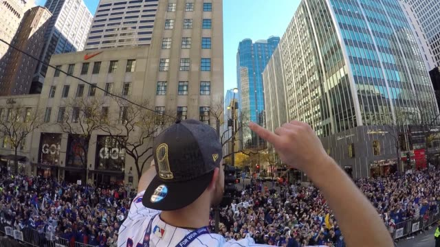 cheering crowds line streets during chicago cubs victory parade on nov. 4, 2016. - baseball world series stock videos & royalty-free footage