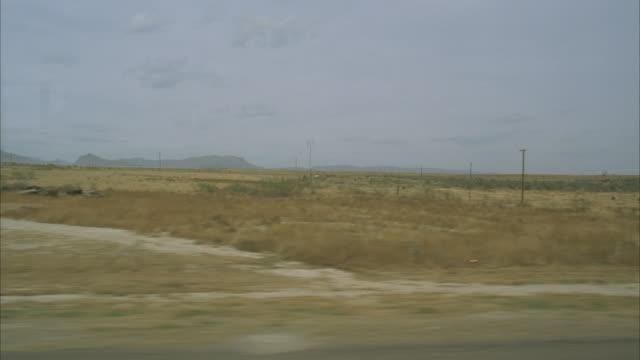 side pov from bus riding through prairie and small town, texas, usa - prairie stock videos & royalty-free footage