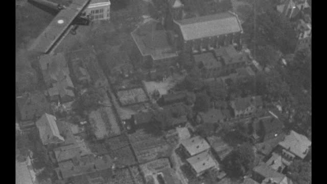pov from camera plane of a us army air service biplane flying over downtown atlanta / vs aerials of the city and environs / note exact month/day not... - 1910 1919 video stock e b–roll