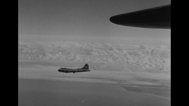 pov from camera plane of b17 flying fortress airplanes flying in sky / pov planes fly above clouds / bombers fly above body of water possibly the... - world water day stock videos and b-roll footage
