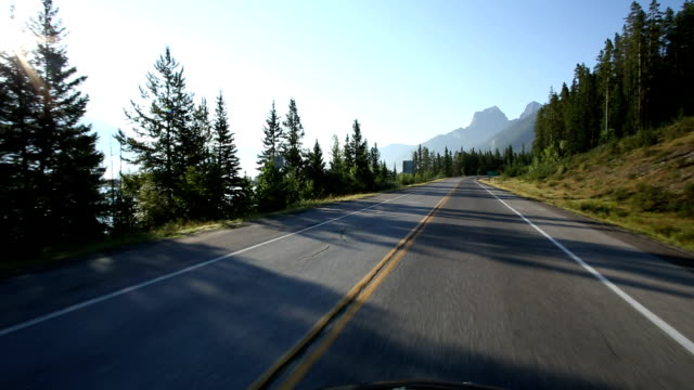 pov from car as it drives along mountain road - road trip stock videos and b-roll footage