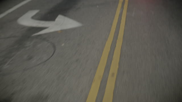 pov from car of markings on road - zebra crossing stock videos & royalty-free footage