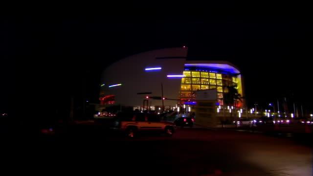 vídeos de stock, filmes e b-roll de side pov from car passing american airlines arena at night, miami, florida, usa - fan palm tree