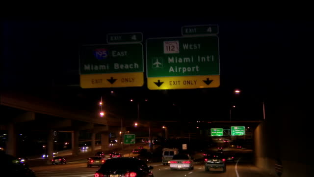 POV from car riding on highway at night, Miami, Florida, USA