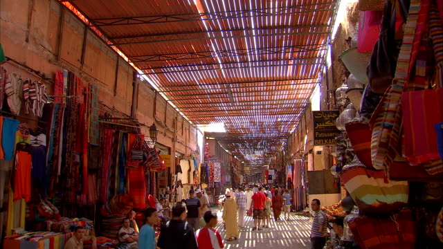 ms td from ceiling to view of busy outdoor market / marrakech, morocco - suq stock-videos und b-roll-filmmaterial