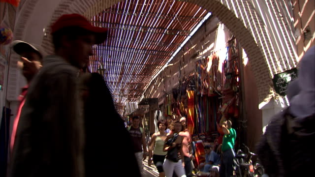 MS TD from ceiling to view of busy outdoor market / Marrakech, Morocco