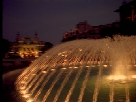 pan from close up of fountain to wide shot of royal palace / monaco - royal palace monaco stock videos and b-roll footage