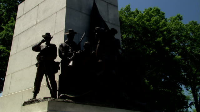 from confederate army statues at base of virginia monument to robert e. lee on traveller statue on top. american civil war, sons at gettysburg - monument stock videos & royalty-free footage