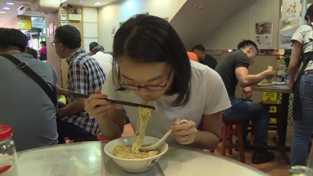 from decades old holes in the wall to multi million dollar businesses hong kong's noodle scene is a sprawling moneyspinner in a city that runs on... - comfort food stock videos & royalty-free footage