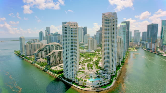 aerial from downtown miami to brickell key in miami, florida - day stock videos & royalty-free footage
