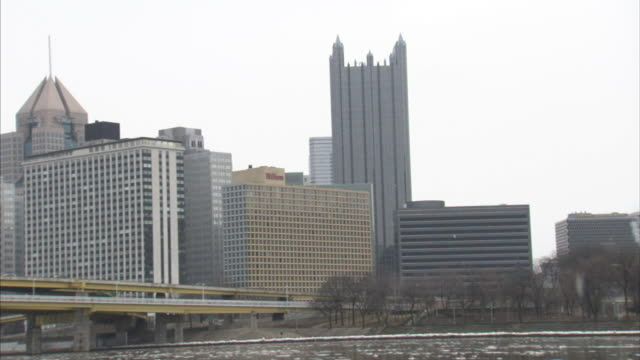 from downtown pittsburgh skyline, including one ppg place, to allegheny river w/ some small floating ice, fort duquesne bridge & the golden triangle,... - 2009 stock videos & royalty-free footage