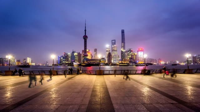 From dusk to night,the visitors at the Bund in Shanghai, China
