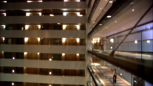 pov from elevator moving down, passing glass walkways, new york city, new york, usa, td - corridor stock videos & royalty-free footage
