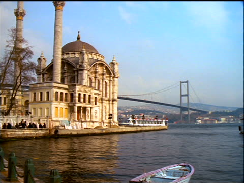 pan from ferry to ortakoy mosque with bosporus bridge in background / istanbul, turkey - july 15 martyrs' bridge stock videos & royalty-free footage