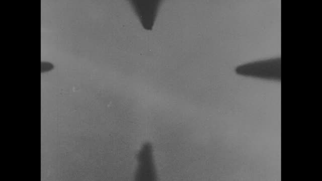 from fighter plane's viewfinder of tracer bullets shooting and downing japanese airplanes high over a new guinean island / note: exact day not known - pacific ocean stock videos & royalty-free footage