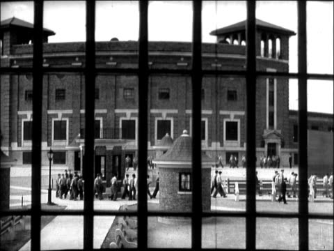 pov from floor of prison cellblock multiple floors of individual prison cells natural light shines in from windows in bg prisoners in silhouette view... - prisoner silhouette stock videos & royalty-free footage