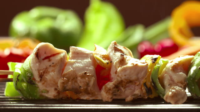 CU TD R/F from fresh vegetables to chicken kebob skewer on open flame grill with fresh chicken meat and slices of bell peppers