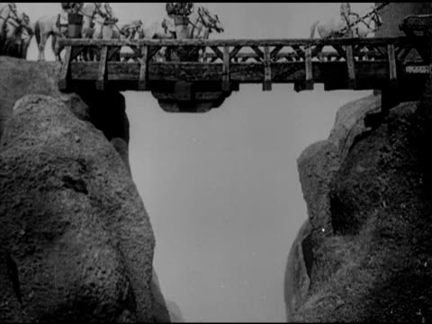 from fritz lang's 'nibelungen' silent film wooden gates being opened horses over bridge paul richter as siegfried riding on white horse walking in... - 1924 stock videos and b-roll footage