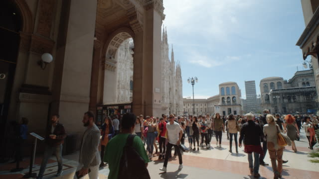 From galleria Vittorio Emanuele II to il duomo square full of tourists. Steady cam dolly shot Milan b-roll