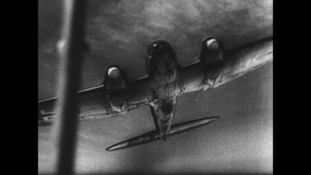 [from german film confiscated by canadian government] german soldier at nose of plane / cu propeller turns / pilot signals from open cockpit closes... - luftwaffe stock-videos und b-roll-filmmaterial