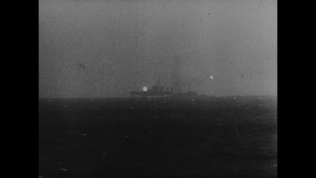 [from german film confiscated by canadian government] ships off shore, waves on beach / vs crashed fighter planes on beach / vs artillery fires... - damaged stock videos & royalty-free footage