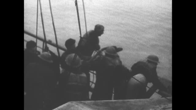 [from german film confiscated by canadian government] view from british gunship just offshore soldiers around artillery background allied soldiers... - evakuierung von dünkirchen stock-videos und b-roll-filmmaterial