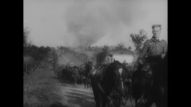 vidéos et rushes de [from german film confiscated by canadian government] vs convoy of german soldiers on the move near dunkirk, france, during world war ii: motorcycles... - seconde guerre mondiale