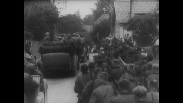 [from german film seized by canadian government; vo in german] montage adolf hitler's motorcade drives on french street as german soldiers salute as... - maginot linie stock-videos und b-roll-filmmaterial