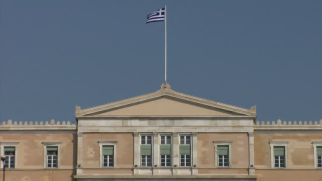 2008 zo from greek flag atop the parliament building to tourists on syntagma square / athens, greece - greek flag stock videos & royalty-free footage