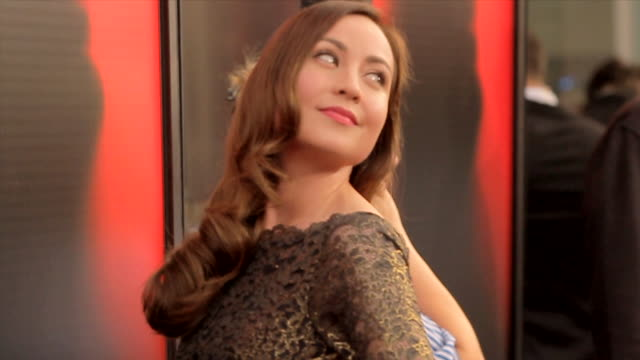 from highheel shoes to courtney ford posing for paparazzi along the red carpet at the arclight cinemas cinerama dome - シネラマドーム点の映像素材/bロール